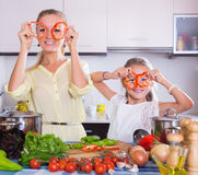 Mother with daughter cooking veggies Stock Image