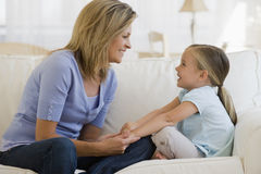 Mother daughter couch Royalty Free Stock Photos