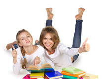 Mother and daughter couching reading books Stock Photography