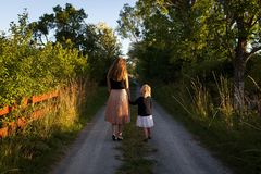 Mother and daughter on country path