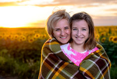 Mother and Daughter on Country Road at Sunset Royalty Free Stock Photography