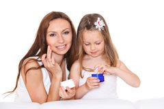 Mother and daughter with cream Royalty Free Stock Photography