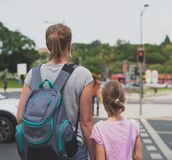 Mother and daughter crossing the road. Royalty Free Stock Photography
