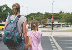 Mother and daughter crossing the road. Royalty Free Stock Photo