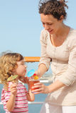 Mother and daughter on cruise liner with cocktail Stock Photography