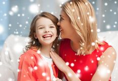 Mother and daughter cuddling Stock Images