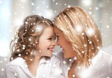 Mother and daughter cuddling Royalty Free Stock Photos