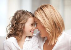 Mother and daughter cuddling Royalty Free Stock Photo
