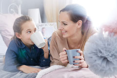 Mother and daughter with cups Stock Photo