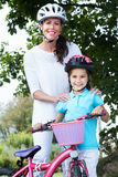 Mother And Daughter On Cycle Ride In Countryside Royalty Free Stock Images