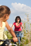 Mother and daughter cycling Stock Photography