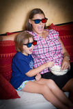 Mother and daughter with 3d glasses screaming looking a film Stock Image