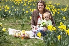 Mother And Daughter In Daffodil Field Royalty Free Stock Image
