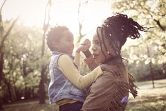 African American mother in nature. royalty free stock images
