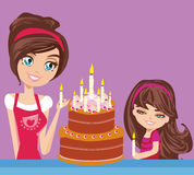 Mother with the daughter decorate the cake Royalty Free Stock Photo