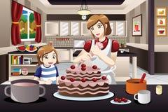 Mother Daughter Decorating a Cake Stock Photos