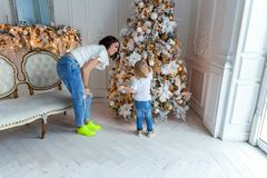 Mother and daughter decorating Christmas tree Royalty Free Stock Photography