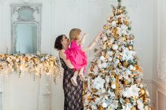 Mother and daughter decorating Christmas tree Royalty Free Stock Photo