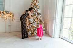 Mother and daughter decorating Christmas tree Royalty Free Stock Photos