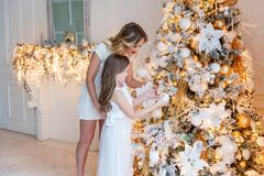 Mother and daughter decorating Christmas tree Stock Photography
