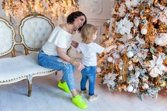 Mother and daughter decorating Christmas tree Stock Photos