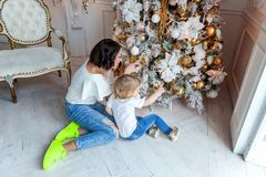 Mother and daughter decorating Christmas tree Royalty Free Stock Images