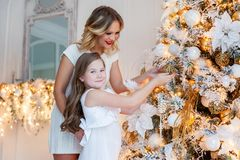 Mother and daughter decorating Christmas tree Stock Image