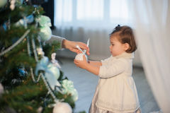 Mother and daughter decorating a Christmas tree toys, holiday, gift, decor, new year, christmas, lifestyle Stock Images