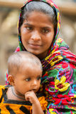 Mother and daughter in Dhaka, Bangladesh. A mother holds her baby daughter in Dhaka, Bangladesh on June 6, 2014 Royalty Free Stock Image