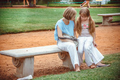 Mother with Daughter in the Difficult Situation. In park royalty free stock images