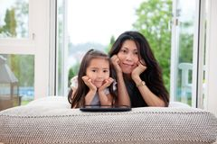 Mother and Daughter with Digital Tablet Stock Images