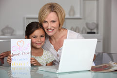 Mother and daughter in dining room Stock Photography