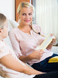 Mother with daughter discussing menstruation and sanitary produc Stock Image
