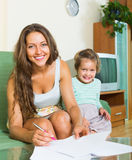 Mother and daughter with document Royalty Free Stock Image