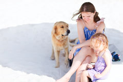 Mother, daughter and dog Stock Images