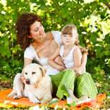 Mother and daughter with dog Stock Photography