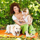 Mother And Daughter With Dog Royalty Free Stock Image