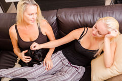 Mother and daughter with a dog Royalty Free Stock Photos