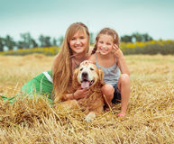 Mother and daughter with a dog Stock Photo