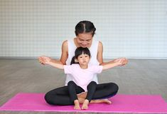 Mother and daughter doing exercise at home.  Royalty Free Stock Photos