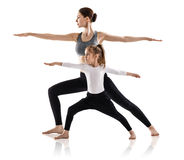 Mother and daughter doing exercise home Stock Photography
