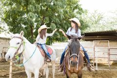 Family Enjoying Horseback Riding At Ranch stock photography
