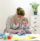 Mother and daughter doing handicrafts. Royalty Free Stock Photo