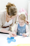 Mother and daughter doing handicrafts. Stock Photo