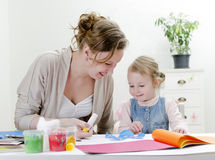 Mother and daughter doing handicrafts. Royalty Free Stock Image