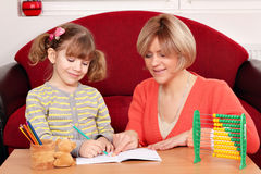Mother and daughter doing homework Stock Photos