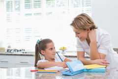 Mother and daughter doing homework Stock Images