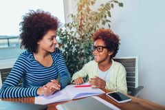 Mother and daughter doing homework learning to calculate royalty free stock photos