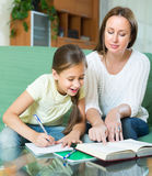 Mother with daughter doing homework Royalty Free Stock Photos