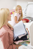 Mother And Daughter Doing Laundry Royalty Free Stock Images